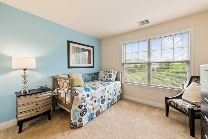 Second bedroom with daybed and chair in front of large window. Click to view the full size image.