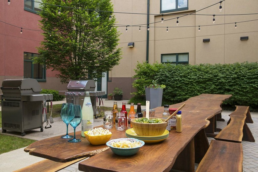 Courtyard with dining area and stainless steel grills