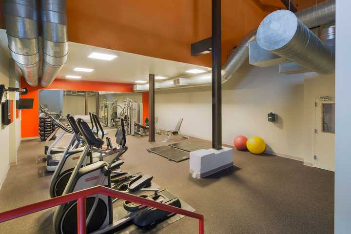Fitness center with cardio and weight lifting equipment . Click to view the full size image.