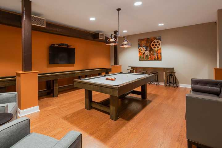 Game room with pool table and shuffleboard. Click to view the full size image.