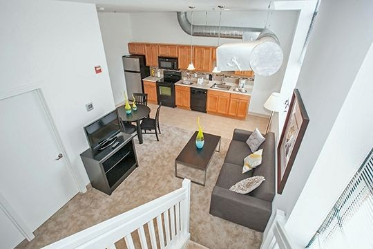 Loft apartment with view of living area and kitchen