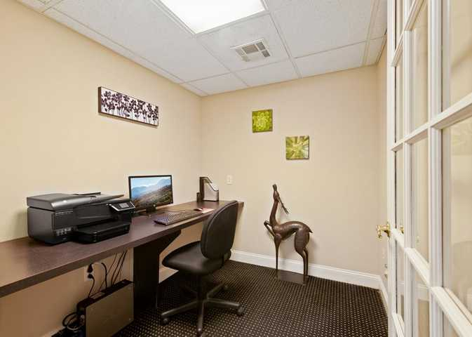 Business center with computer, 3-in-1- printer, and deer sculpture. Click to view the full size image.