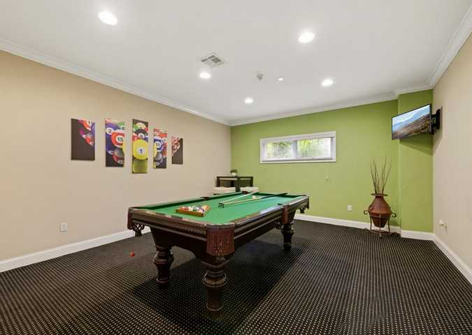 Billiard room with TV in the corner. Click to view the full size image.