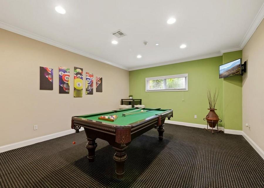 Billiard room with TV in the corner