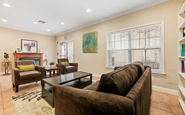 Clubhouse seating area with couch, coffee table, and chairs. Click to view the full size image.
