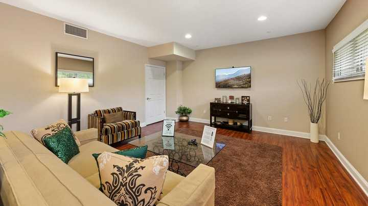 Clubroom with couch and television. Click to view the full size image.