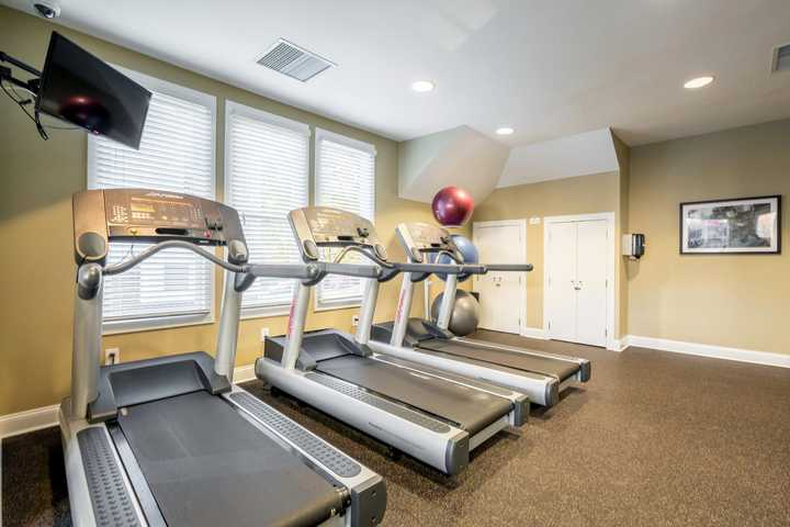 fitness center with treadmills, television and windows. Click to view the full size image.