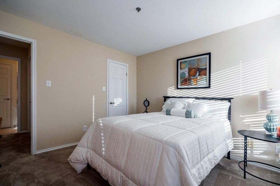 bedroom with white bedding, side tables