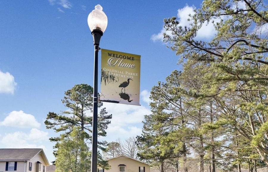 light post with welcome home banner