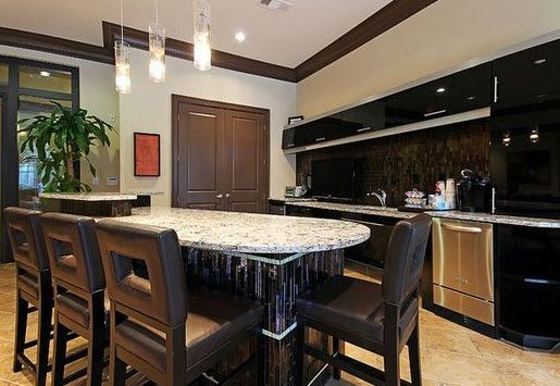 resident kitchen and bar top with stools