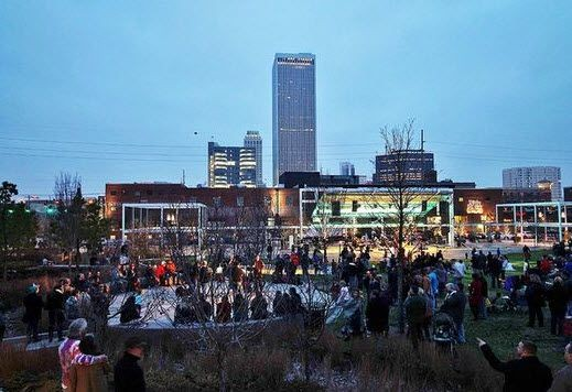 Guthrie Green at dusk with Downtown views