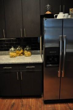 apartment kitchen with stainless fridge