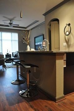 apartment kitchen island with barstools. Click to view the photo gallery.