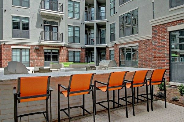 Outdoor kitchen with grills and seating. Click to view the photo gallery.