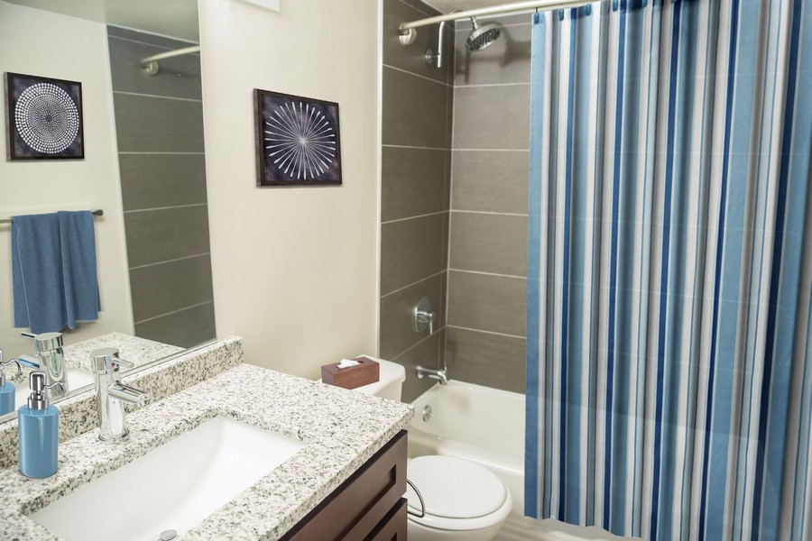 bathroom with sink, toilet and shower/tub.