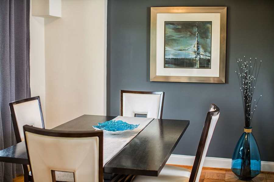 dining room table with 4 chairs, art on the wall
