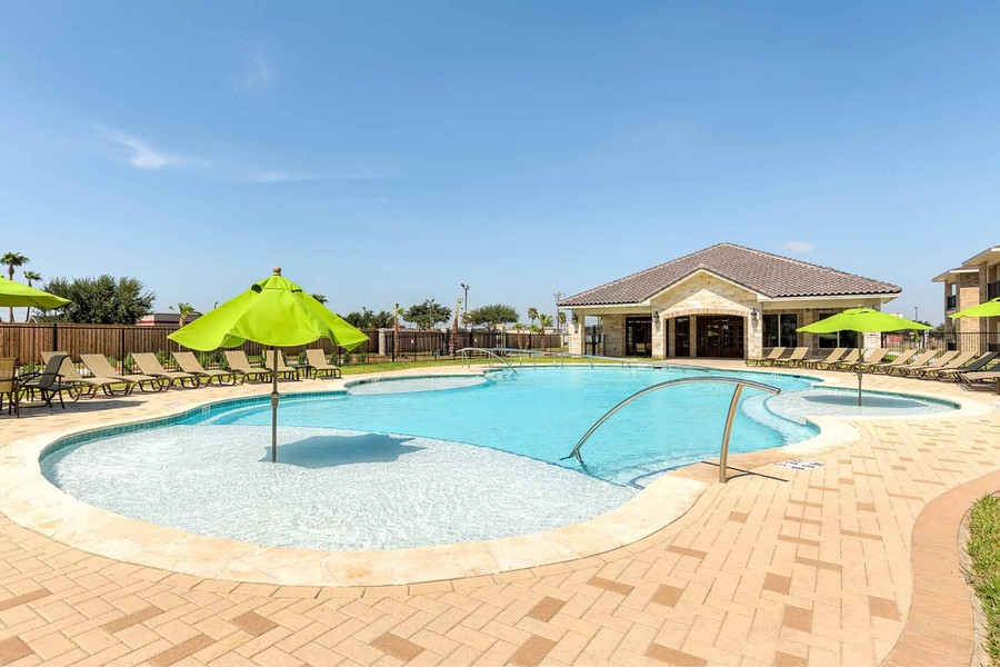 Property pool with umbrellas