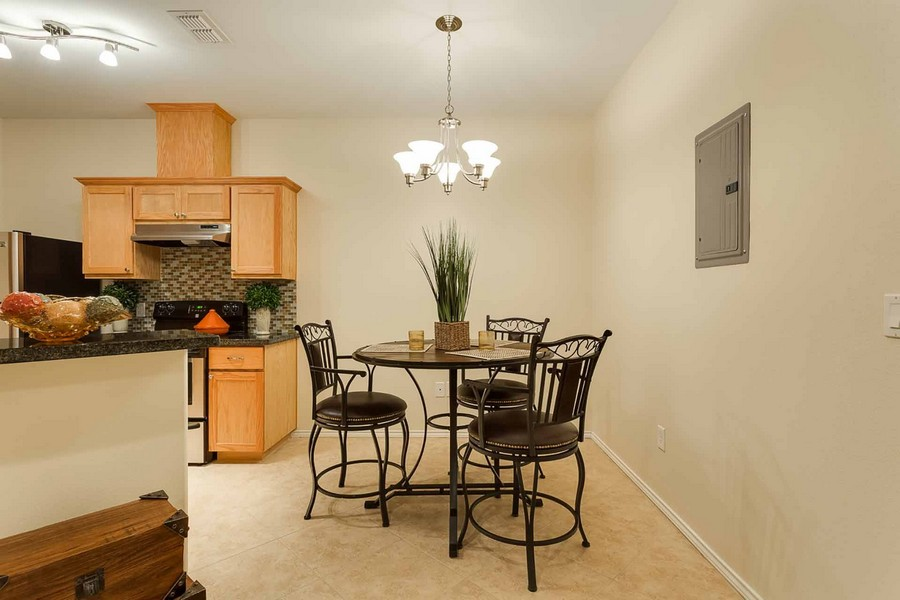 Apartment dining area with table and chairs