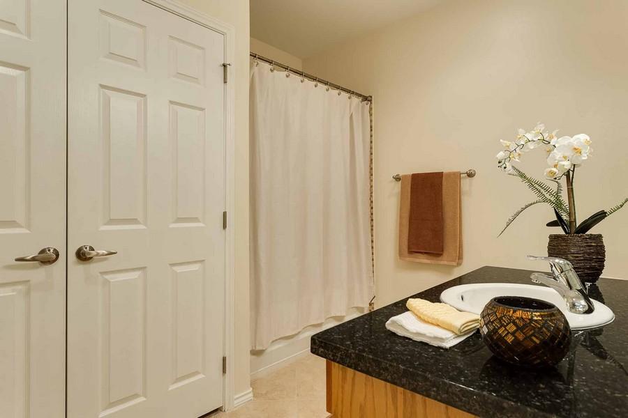 Bathroom with granite countertops and large closet doors