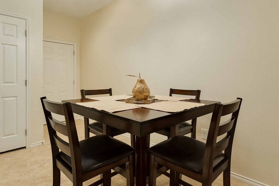 Dark square table and chairs in apartment kitchen
