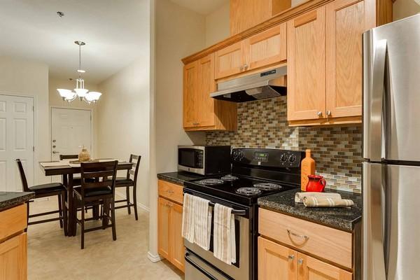 Kitchen stove area with tile backsplash
