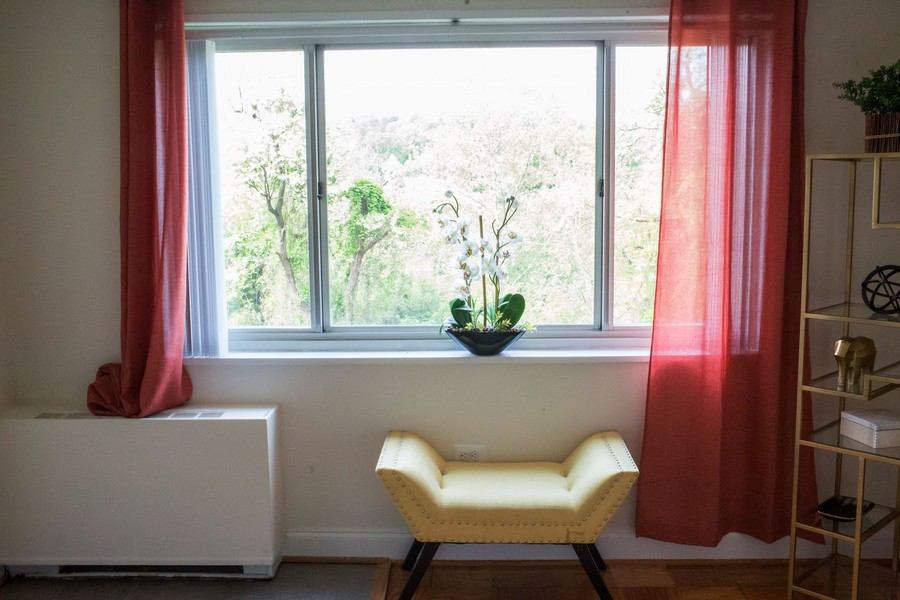window with curtains, chair and shelves
