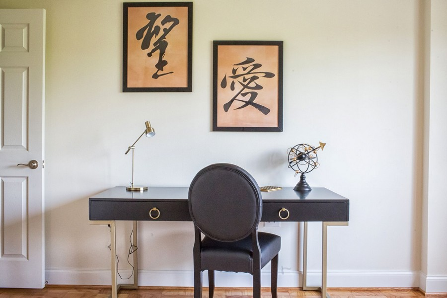desk, chair and artwork