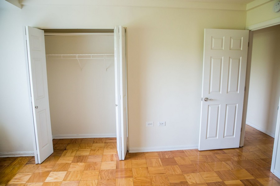 bedroom with closet and parquet flooring