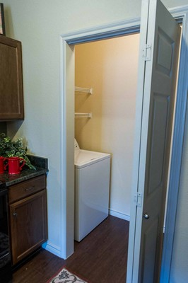 Laundry room in apartment. Click to view the photo gallery.