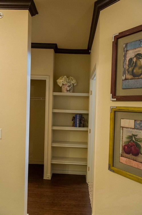 Built-in shelves in apartment hallway