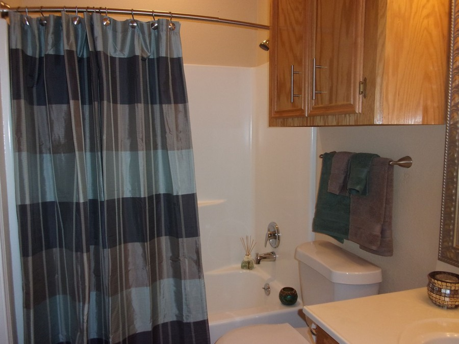 Apartment bathroom with shower tub