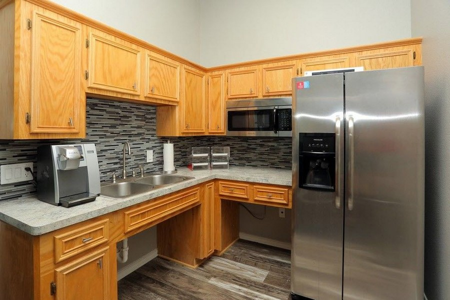 Apartment Kitchen with Stainless Steel Refrigerator