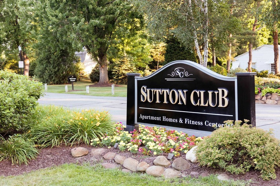 Sutton Club Apartment signage