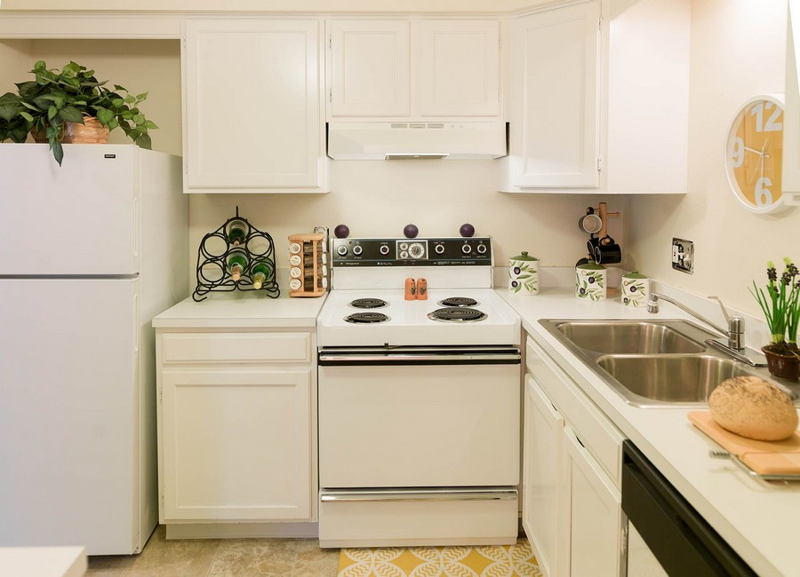 Apartment kitchen with white cabinets