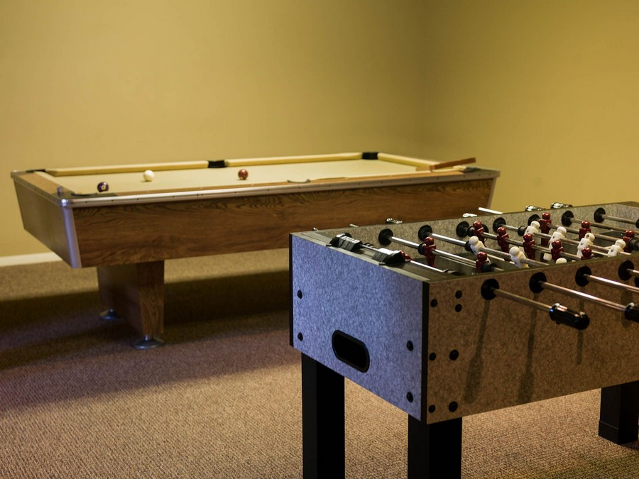 Room with billiard table and a Foosball table