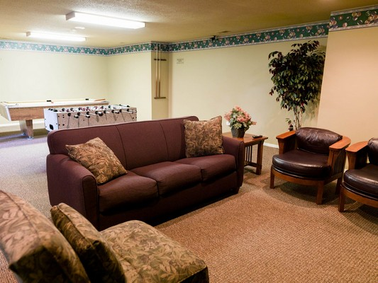 Apartment clubhouse seating area overlooking Foosball and billiard table. Click to view the photo gallery.