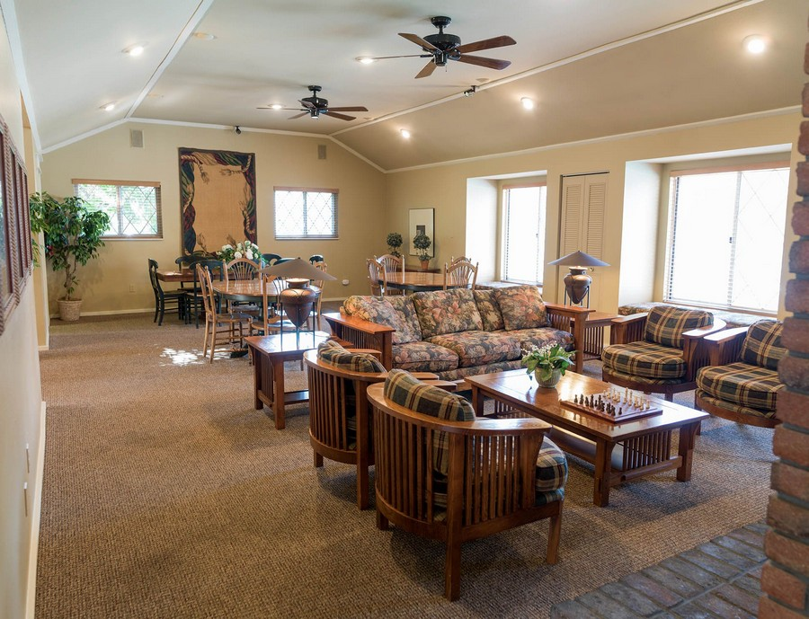 View of apartment clubhouse with couches and tables