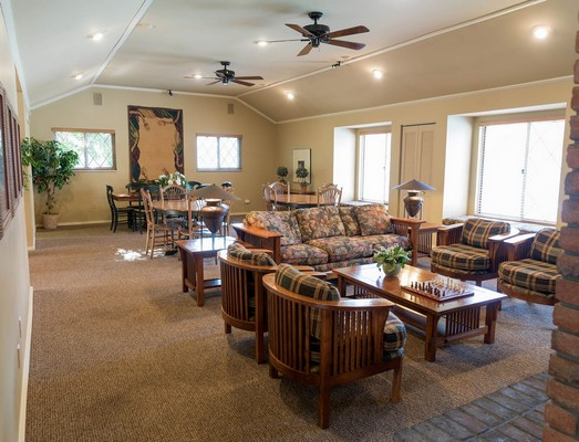 View of apartment clubhouse with couches and tables. Click to view the photo gallery.