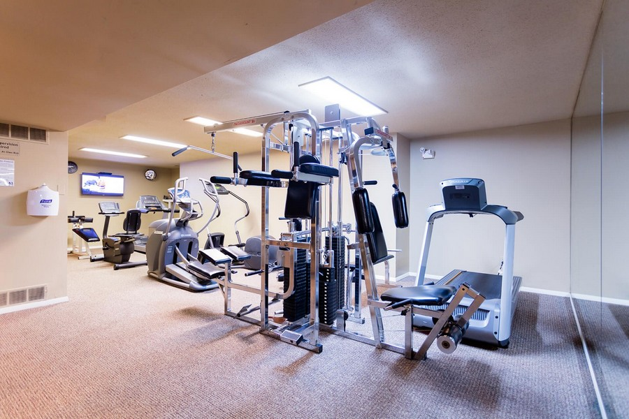 Apartment gym with cardio and weight equipments