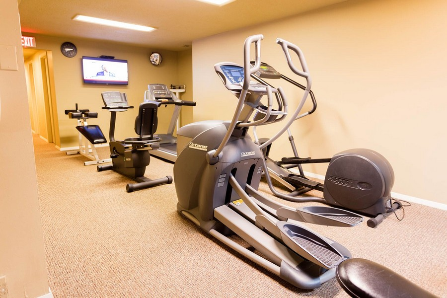 Apartment gym with cardio equipments