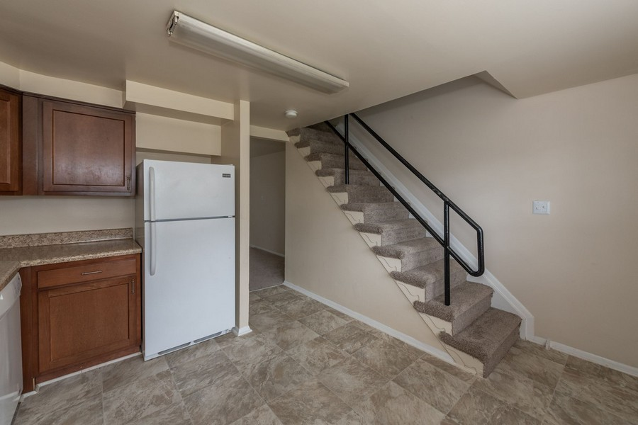 stairs coming down to kitchen