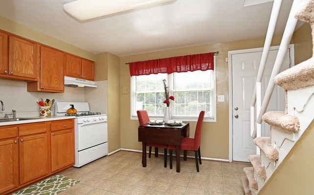 kitchen with stairs and eat in table. Click to view the photo gallery.