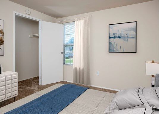 bedroom with carpet and closet