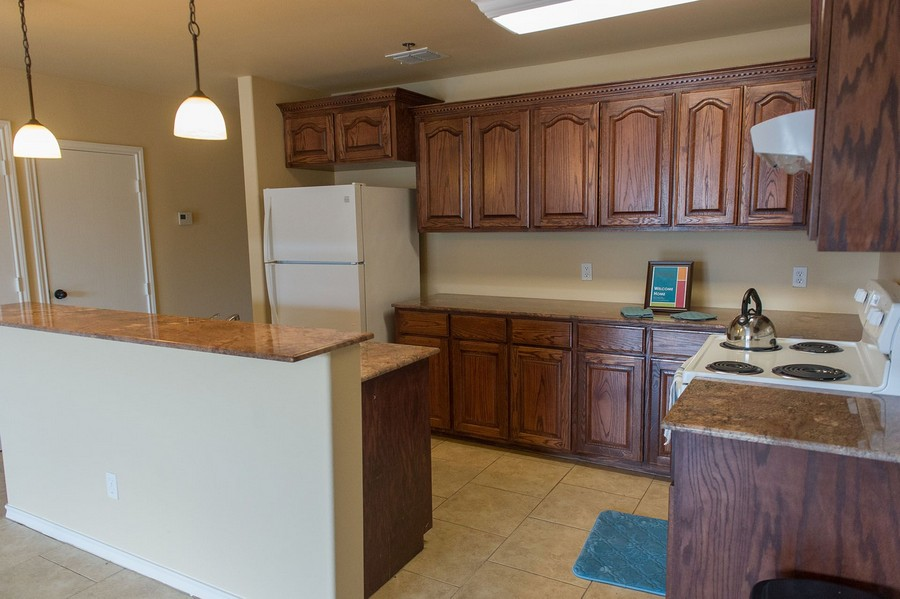 Apartment Kitchen with brown cabinets.