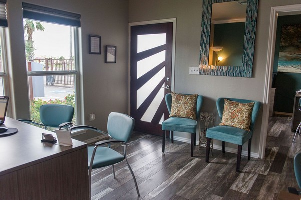 Apartment Leasing office with blue chairs. Click to view the photo gallery.