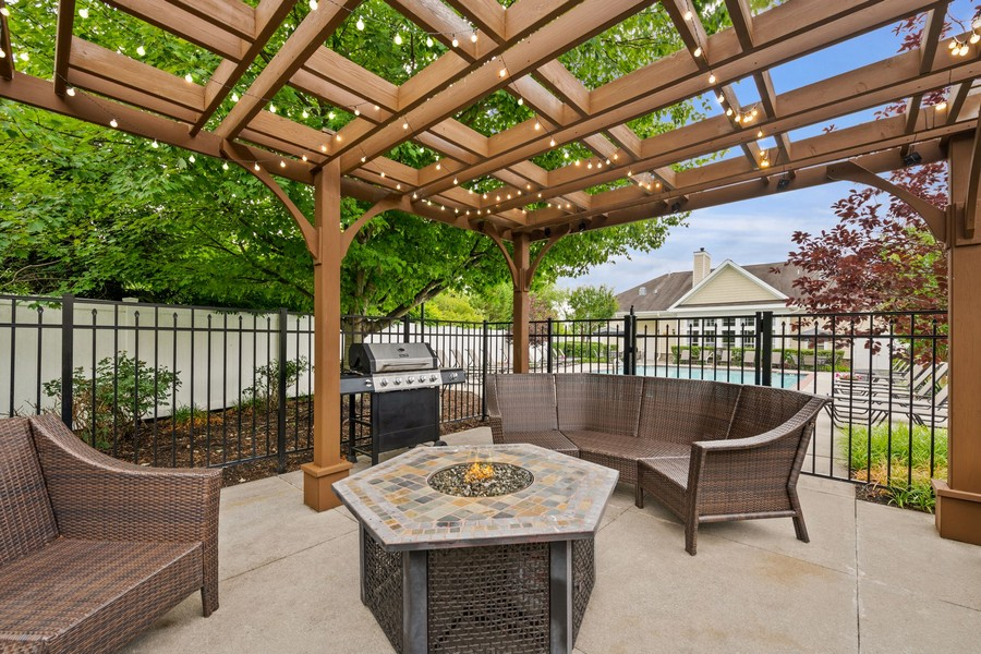 Outdoor fire pit with seating and grill
