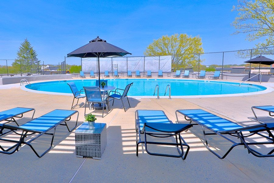 Round swimming pool with tanning chairs