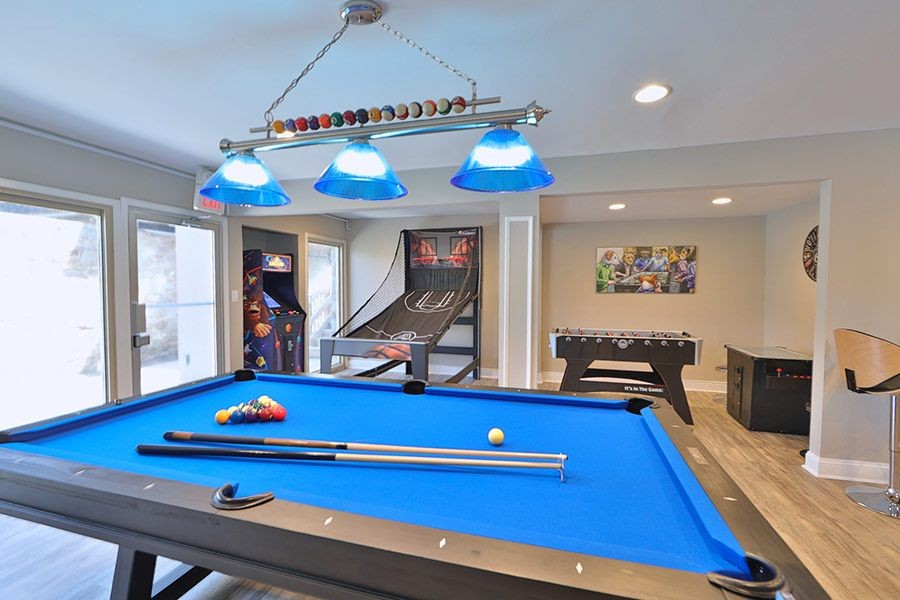Community game room with arcade games and pool table.