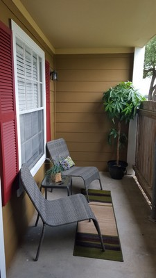Covered patio with chairs. Click to view the photo gallery.