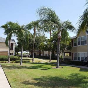 Walking trail around the lush green lawns and apartment building in the background.. Click for photo gallery.